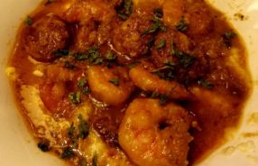 shrimp and grits with crawfish sausage